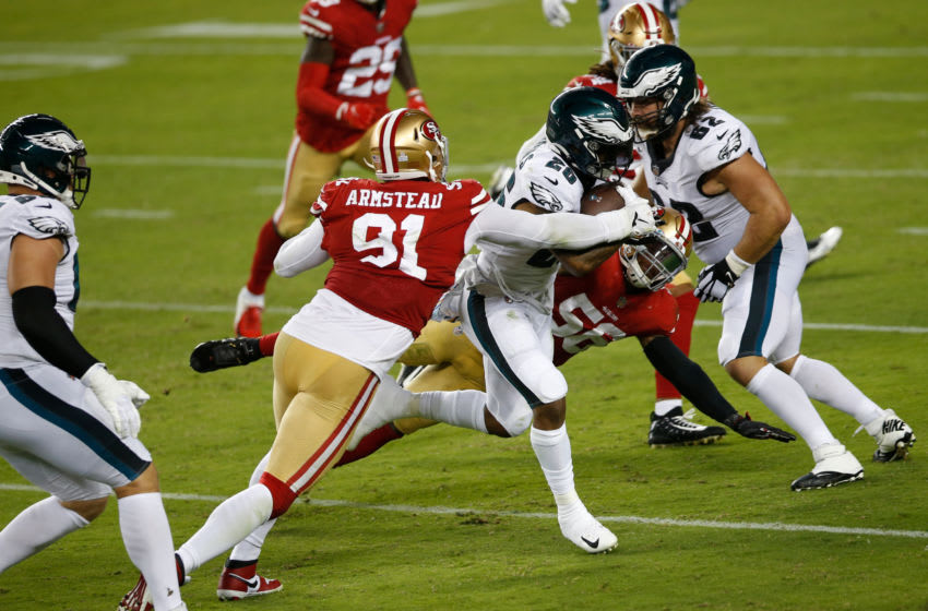 Arik Armstead #91 of the San Francisco 49ers tackles Miles Sanders #26 of the Philadelphia Eagles (Photo by Michael Zagaris/San Francisco 49ers/Getty Images)