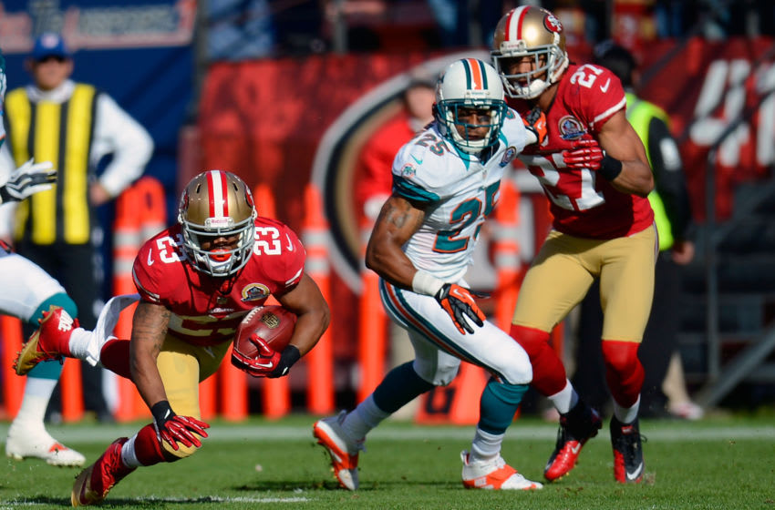 LaMichael James #23 of the San Francisco 49ers dives against the Miami Dolphins (Photo by Thearon W. Henderson/Getty Images)