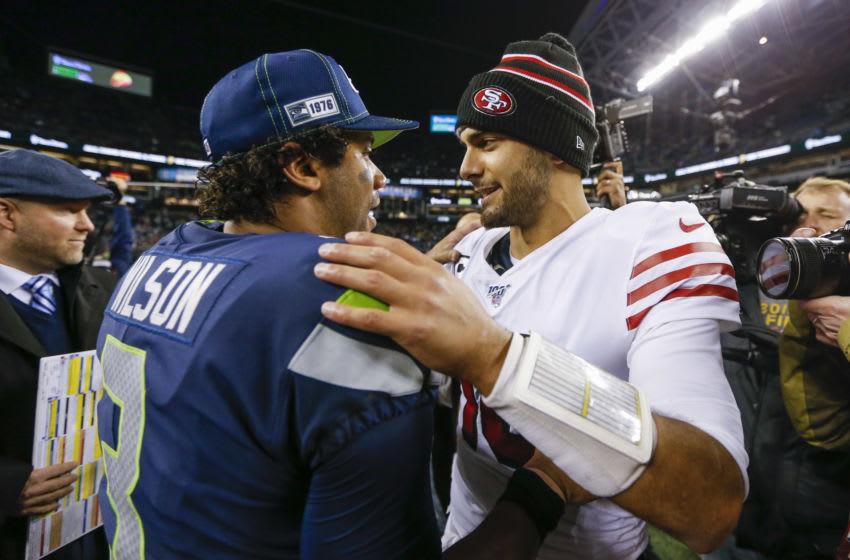 San Francisco 49ers quarterback Jimmy Garoppolo (10) with Seattle Seahawks quarterback Russell Wilson (3) Mandatory Credit: Joe Nicholson-USA TODAY Sports