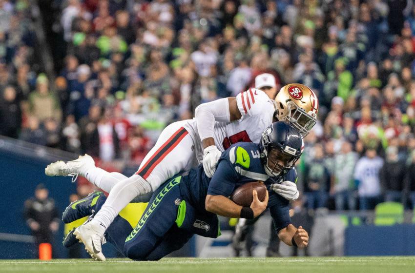 San Francisco 49ers linebacker Dre Greenlaw (57) sacks Seattle Seahawks quarterback Russell Wilson (3) Mandatory Credit: Kyle Terada-USA TODAY Sports