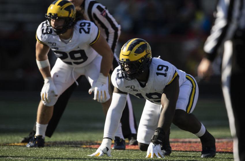 Michigan Wolverines defensive lineman Kwity Paye (19) and linebacker Jordan Glasgow (29) Mandatory Credit: Tommy Gilligan-USA TODAY Sports