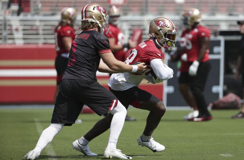 San Francisco 49ers running back Jerick McKinnon (28) receives the hand off from quarterback C.J. Beathard (3) Mandatory Credit: San Francisco 49ers/Pool Photo via USA TODAY Network