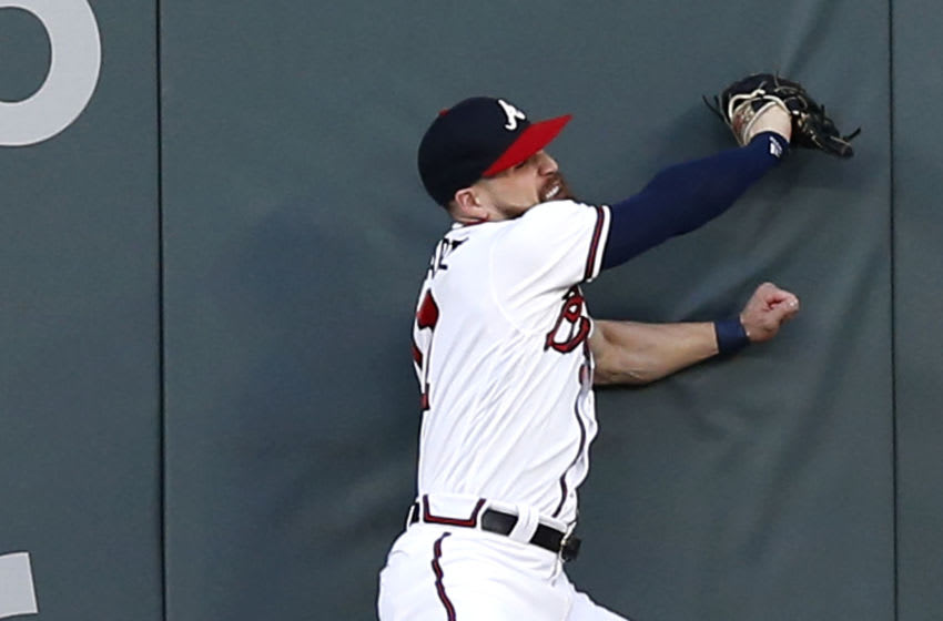 ATLANTA, GA - AUGUST 31: Centerfielder Ender Inciarte #11 of the Atlanta Braves makes a leaping catch on a fly ball in the first inning during the game against the Pittsburgh Pirates at SunTrust Park on August 31, 2018 in Atlanta, Georgia. (Photo by Mike Zarrilli/Getty Images)