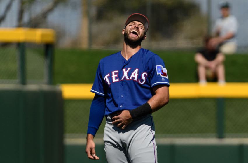 MESA, ARIZONA - MARCH 05: Joey Gallo #13 of the Texas Rangers laughs while warming up for the spring training game against the Oakland Athletics at HoHoKam Stadium on March 05, 2019 in Mesa, Arizona. (Photo by Jennifer Stewart/Getty Images)
