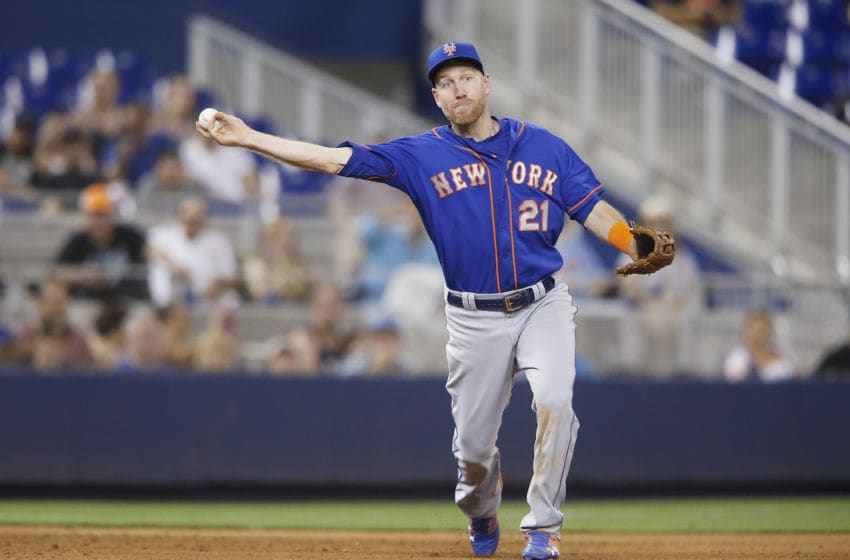 MIAMI, FLORIDA - JULY 13: Todd Frazier #21 of the New York Mets throws out a runner at first base during a game against the Miami Marlins at Marlins Park on July 13, 2019 in Miami, Florida. (Photo by Michael Reaves/Getty Images)
