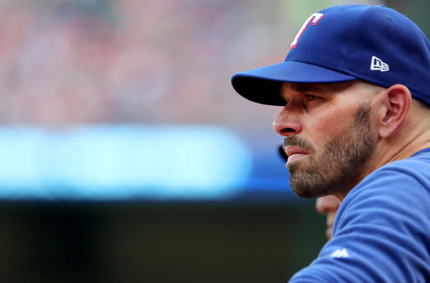ARLINGTON, TEXAS - AUGUST 02: Manager Chris Woodward #8 of the Texas Rangers leads the Texas Rangers against the Detroit Tigersat Globe Life Park in Arlington on August 02, 2019 in Arlington, Texas. (Photo by Tom Pennington/Getty Images)