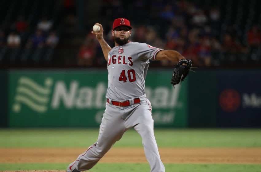 ARLINGTON, TEXAS - AUGUST 21: Luis Garcia #40 of the Los Angeles Angels throws against the Los Angeles Angels at Globe Life Park in Arlington on August 21, 2019 in Arlington, Texas. (Photo by Ronald Martinez/Getty Images)