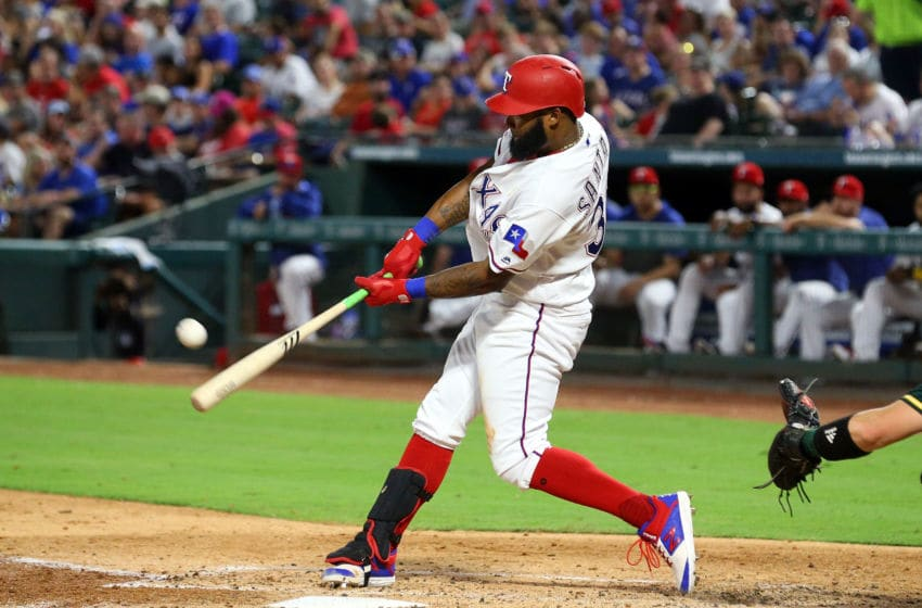 ARLINGTON, TEXAS - SEPTEMBER 13: Danny Santana #38 of the Texas Rangers hits a three run home run in the third inning against the Oakland Athletics at Globe Life Park in Arlington on September 13, 2019 in Arlington, Texas. (Photo by Richard Rodriguez/Getty Images)