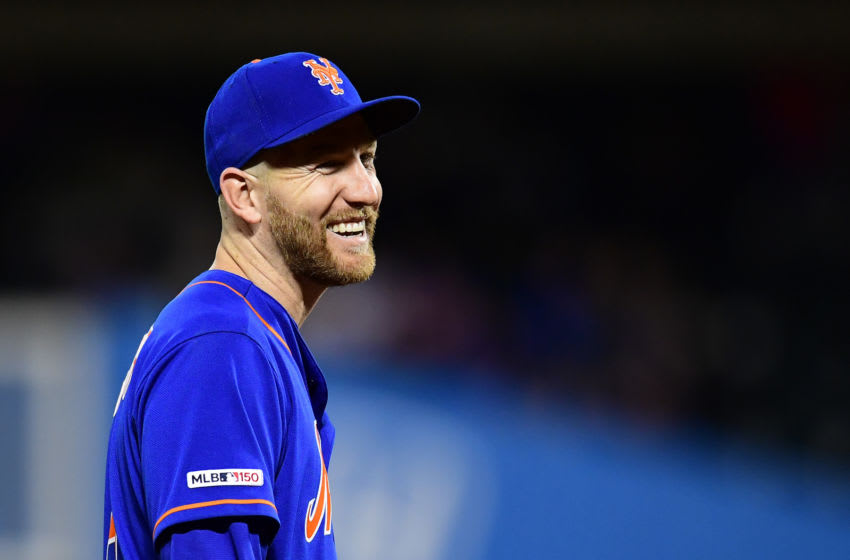 NEW YORK, NEW YORK - SEPTEMBER 27: Todd Frazier #21 of the New York Mets smiles in the seventh inning of their game against the Atlanta Braves at Citi Field on September 27, 2019 in the Flushing neighborhood of the Queens borough of New York City. (Photo by Emilee Chinn/Getty Images)