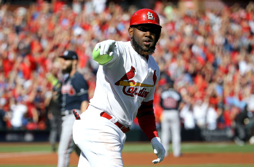 ST LOUIS, MISSOURI - OCTOBER 07: Marcell Ozuna #23 of the St. Louis Cardinals celebrates after hitting a solo home run against the Atlanta Braves during the first inning in game four of the National League Division Series at Busch Stadium on October 07, 2019 in St Louis, Missouri. (Photo by Scott Kane/Getty Images)