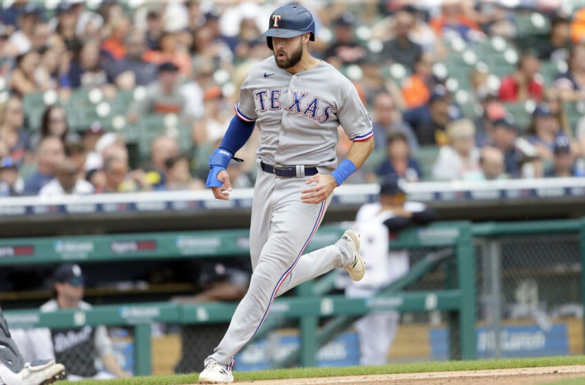 DETROIT, MI - JULY 22: Joey Gallo #13 of the Texas Rangers scores against the Detroit Tigers on single by David Dahl during the sixth inning at Comerica Park on July 22, 2021, in Detroit, Michigan. (Photo by Duane Burleson/Getty Images)