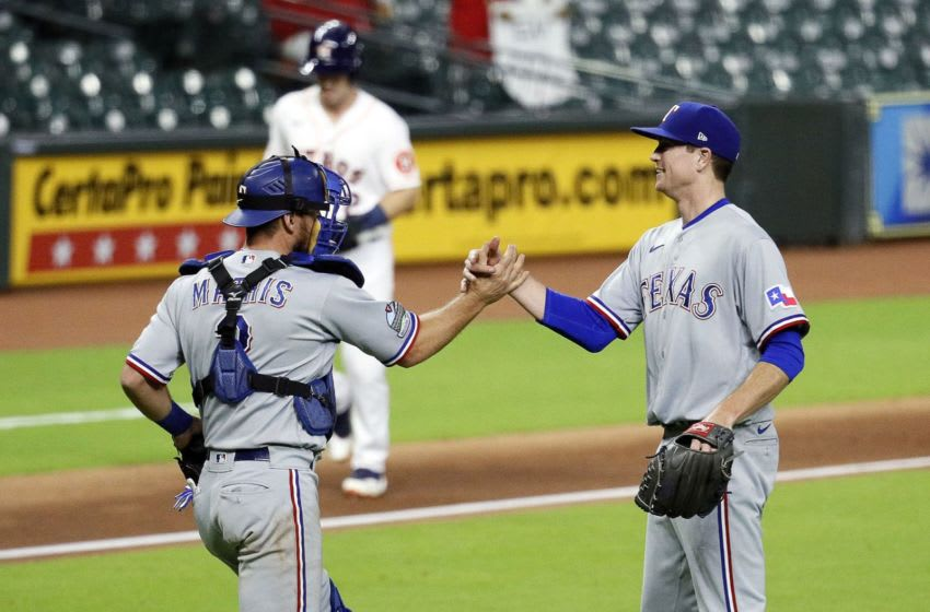 Kyle Gibson delivers a complete game shutout for the Texas Rangers in 1-0 win over Houston Astros (Photo by Bob Levey/Getty Images)