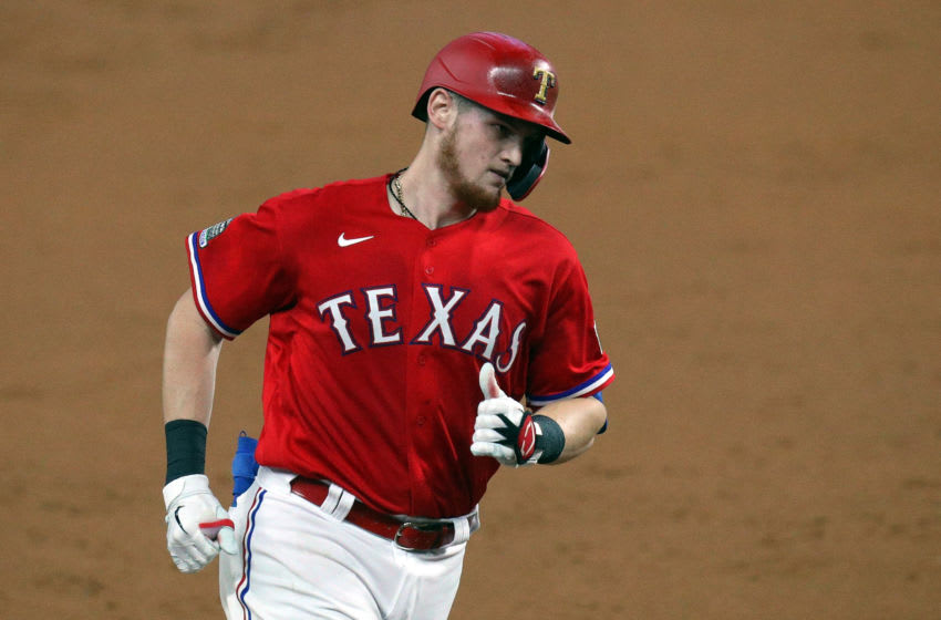 Texas Rangers catcher Sam Huff hits a home run against the Houston Astros (Photo by Richard Rodriguez/Getty Images)