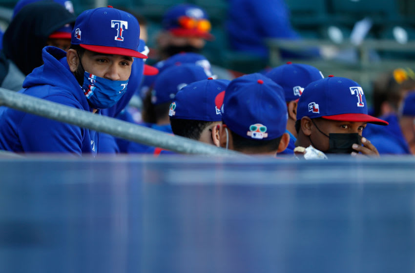 SURPRISE, ARIZONA - MARCH 01: The Texas Rangers reserve players sit in the seats during the MLB spring training game against the San Francisco Giants on March 01, 2021 in Surprise, Arizona. (Photo by Christian Petersen/Getty Images)
