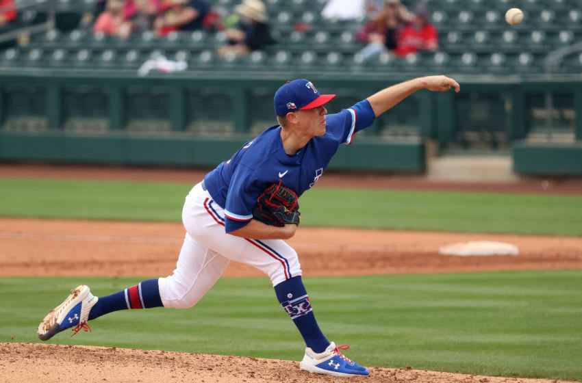 SURPRISE, ARIZONA - MARCH 23: Kolby Allard #39 of the Texas Rangers pitches in the fifth inning against the Los Angeles Angels during the MLB spring training game at Surprise Stadium on March 23, 2021 in Surprise, Arizona. (Photo by Abbie Parr/Getty Images)