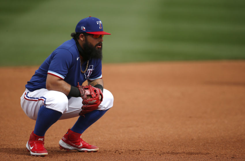 SURPRISE, ARIZONA - MARCH 07: Third baseman Rougned Odor #12 of the Texas Rangers kneels down during the fourth inning of the MLB spring training baseball game against the Los Angeles Dodgers at Surprise Stadium on March 07, 2021 in Surprise, Arizona. (Photo by Ralph Freso/Getty Images)