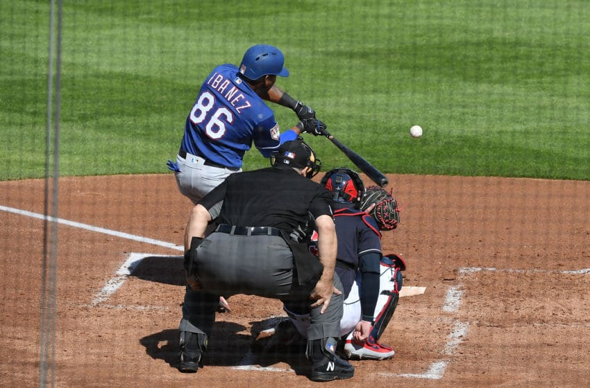 GOODYEAR, AZ - FEBRUARY 25: Andy Ibanez #86 of the Texas Rangers hits a single during the third inning of a spring training game against the Cleveland Indians at Goodyear Ballpark on February 25, 2019 in Goodyear, Arizona. (Photo by Norm Hall/Getty Images)