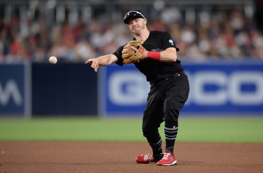 Aug 24, 2019; San Diego, CA, USA; Boston Red Sox second baseman Brock Holt throws to first base on a ground out by San Diego Padres left fielder Josh Naylor (not pictured) in the fifth inning during an MLB Players' Weekend game at Petco Park. Mandatory Credit: Orlando Ramirez-USA TODAY Sports