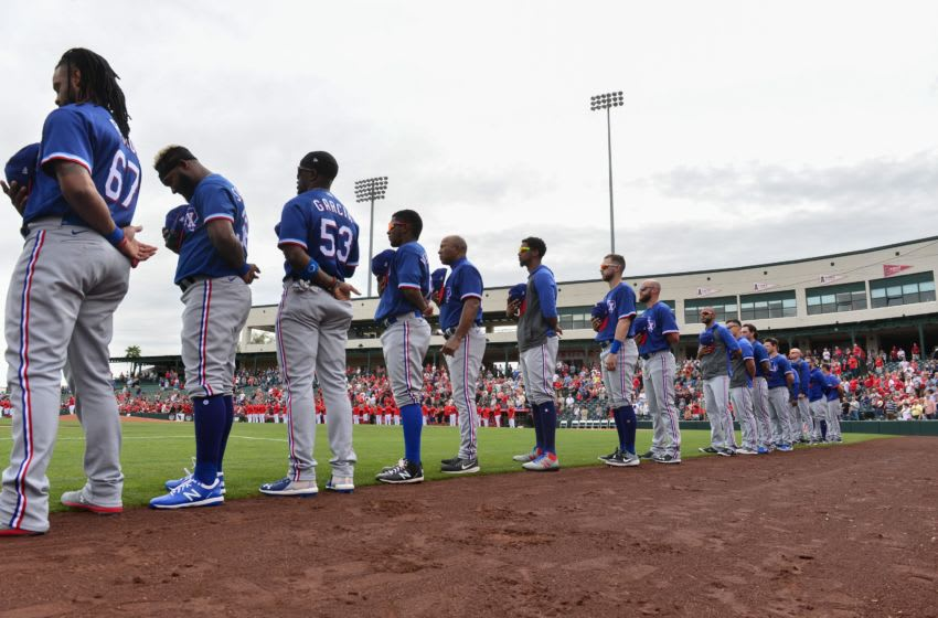 Feb 28, 2020; Tempe, Arizona, USA; The Texas Rangers look on during the national anthem prior to the game against the Los Angeles Angels at Tempe Diablo Stadium. Mandatory Credit: Matt Kartozian-USA TODAY Sports