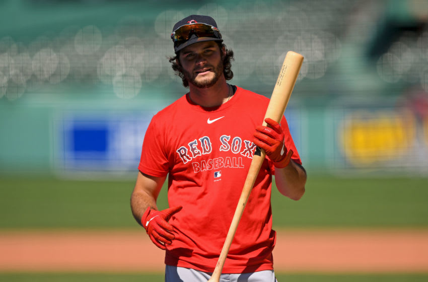 Jul 4, 2020; Boston, Massachusetts, United States; Boston Red Sox left fielder Andrew Benintendi (16) walks off of the field during practice at Fenway Park. Mandatory Credit: Brian Fluharty-USA TODAY Sports