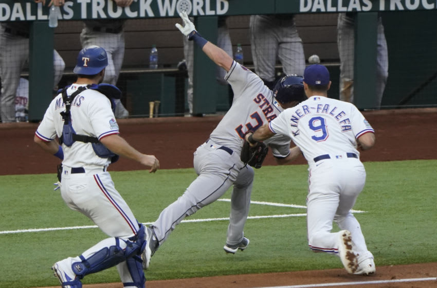 Sep 26, 2020; Arlington, Texas, USA; Houston Astros center fielder Myles Straw (3) is tagged by Texas Rangers third baseman Isiah Kiner-Falefa (9) in a run-down between third base and home as catcher Jeff Mathis (2) watches during the third inning at Globe Life Field. Mandatory Credit: Jim Cowsert-USA TODAY Sports