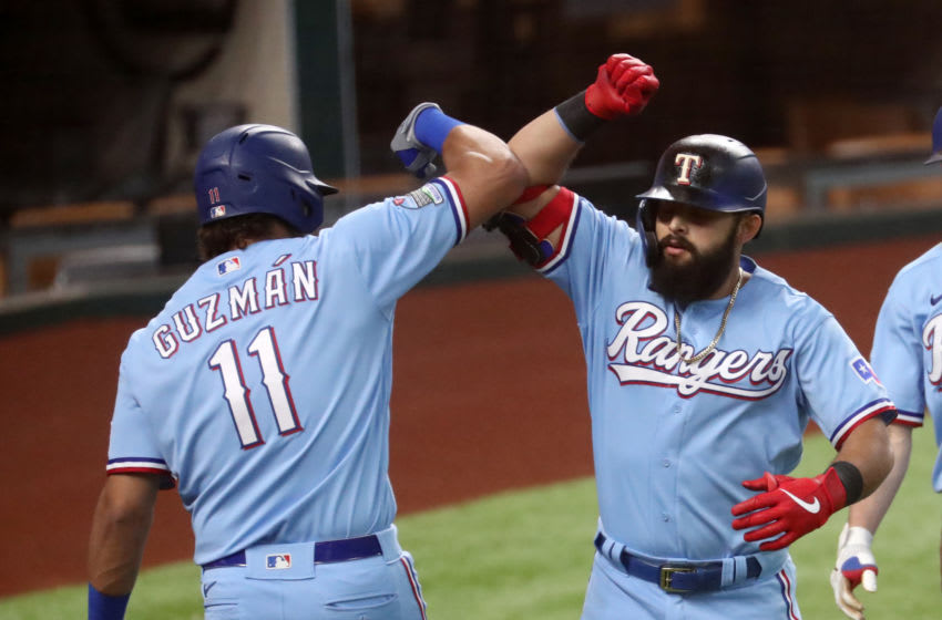 Sep 27, 2020; Arlington, Texas, USA; Texas Rangers second baseman Rougned Odor (12) celebrates with first baseman Ronald Guzman (11) after hitting a three run home run during the fourth inning against the Houston Astros at Globe Life Field. Mandatory Credit: Kevin Jairaj-USA TODAY Sports
