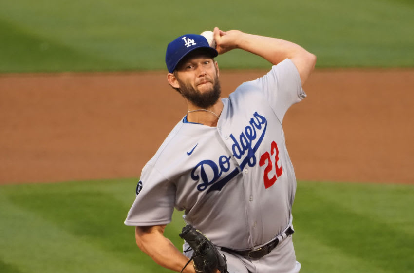 Apr 6, 2021; Oakland, California, USA; Los Angeles Dodgers starting pitcher Clayton Kershaw (22) pitches the ball against the Oakland Athletics during the first inning at RingCentral Coliseum. Mandatory Credit: Kelley L Cox-USA TODAY Sports