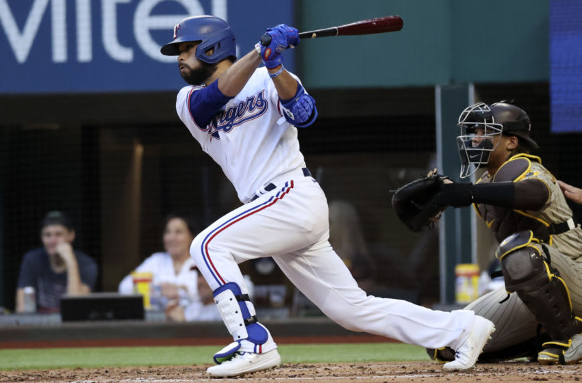 Apr 10, 2021; Arlington, Texas, USA; Texas Rangers shortstop Isiah Kiner-Falefa (9) hits a two-run double during the second inning against the San Diego Padres at Globe Life Field. Mandatory Credit: Kevin Jairaj-USA TODAY Sports