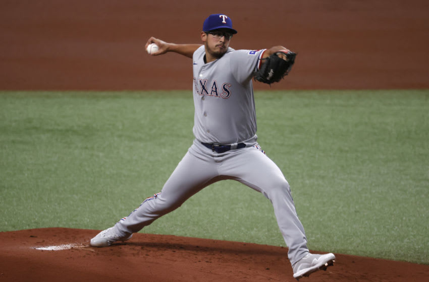 Apr 12, 2021; St. Petersburg, Florida, USA; Texas Rangers starting pitcher Dane Dunning (33) throws against the Tampa Bay Rays during the first inning at Tropicana Field. Mandatory Credit: Kim Klement-USA TODAY Sports