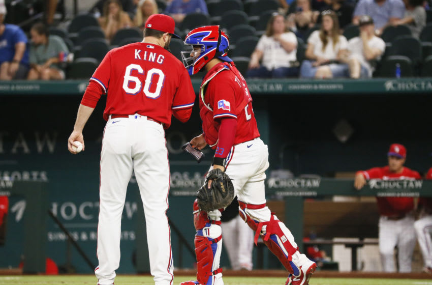 Jun 4, 2021; Arlington, Texas, USA; Texas Rangers relief pitcher John King (60) and catcher Jose Trevino (23) talk between pitches during the sixth inning against the Tampa Bay Rays at Globe Life Field. Mandatory Credit: Raymond Carlin III-USA TODAY Sports