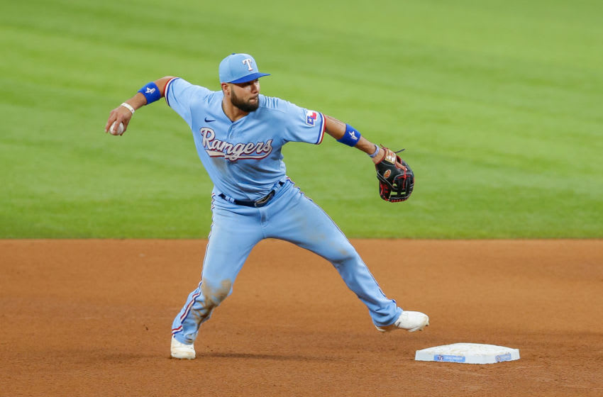 Jun 6, 2021; Arlington, Texas, USA; Texas Rangers third baseman Isiah Kiner-Falefa (9) turns an unassisted double play during the fifth inning against the Tampa Bay Rays at Globe Life Field. Mandatory Credit: Andrew Dieb-USA TODAY Sports