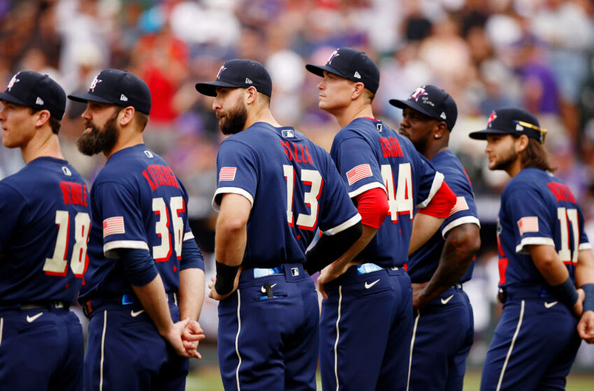 Jul 13, 2021; Denver, Colorado, USA; American League outfielder Joey Gallo of the Texas Rangers (13) and fellow American League All Stars watch as the lineups are announced before the 2021 MLB All Star Game at Coors Field. Mandatory Credit: Isaiah J. Downing-USA TODAY Sports