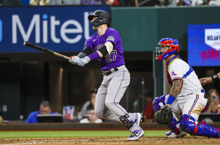Aug 30, 2021; Arlington, Texas, USA; Colorado Rockies shortstop Trevor Story (27) hits a two-run home run during the eighth inning against the Texas Rangers at Globe Life Field. Mandatory Credit: Kevin Jairaj-USA TODAY Sports
