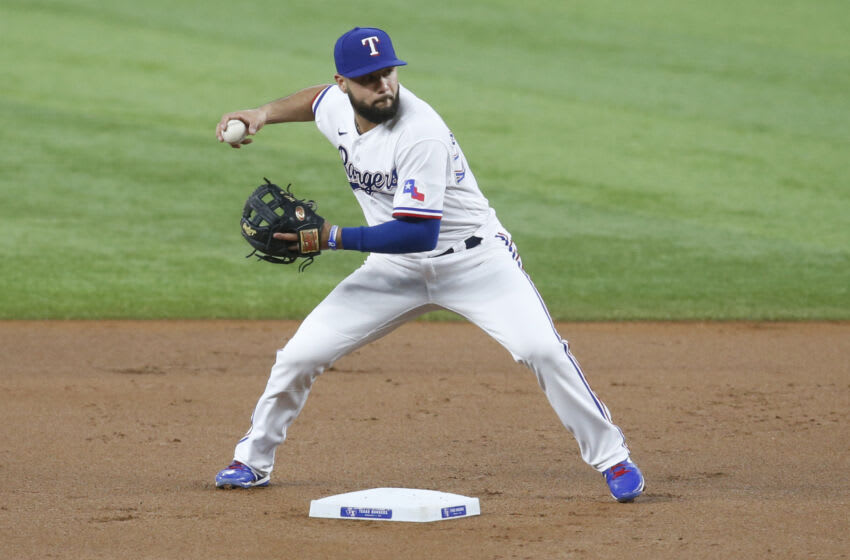 Sep 18, 2021; Arlington, Texas, USA; Texas Rangers shortstop Isiah Kiner-Falefa (9) attempts to turn a double play in the first inning against the Chicago White Sox at Globe Life Field. Mandatory Credit: Tim Heitman-USA TODAY Sports