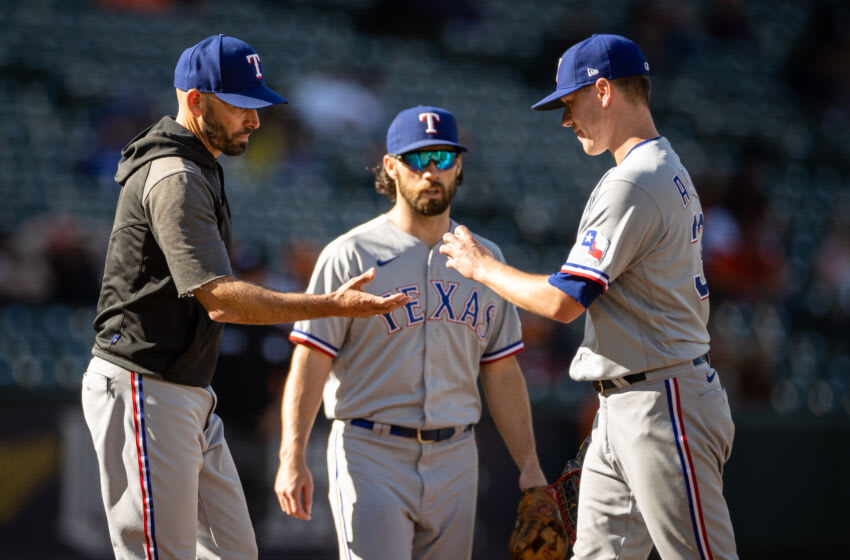 Sep 26, 2021; Baltimore, Maryland, USA; Texas Rangers manager Chris Woodward (8) relieves relief pitcher Kolby Allard (39) during the ninth inning of the game against the Baltimore Orioles at Oriole Park at Camden Yards. Mandatory Credit: Scott Taetsch-USA TODAY Sports