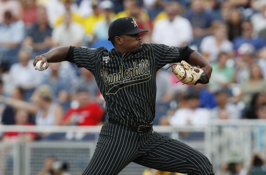 Jun 25, 2019; Omaha, NE, USA; Vanderbilt Commodores starting pitcher Kumar Rocker (80) throws the ball during the first inning against the Michigan Wolverines in game two of the championship series of the 2019 College World Series at TD Ameritrade Park. Mandatory Credit: Bruce Thorson-USA TODAY Sports
