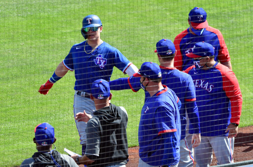 Mar 3, 2021; Tempe, Arizona, USA; Texas Rangers right fielder Steele Walker (74) celebrates with teammates after hitting a solo home run during the third inning against the Los Angeles Angels during a spring training game at Tempe Diablo Stadium. Mandatory Credit: Matt Kartozian-USA TODAY Sports