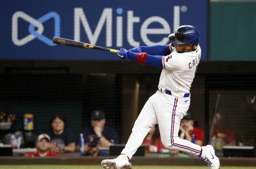 May 1, 2021; Arlington, Texas, USA; Texas Rangers left fielder Willie Calhoun (5) hits a two-run home run during the sixth inning against the Boston Red Sox at Globe Life Field. Mandatory Credit: Raymond Carlin III-USA TODAY Sports