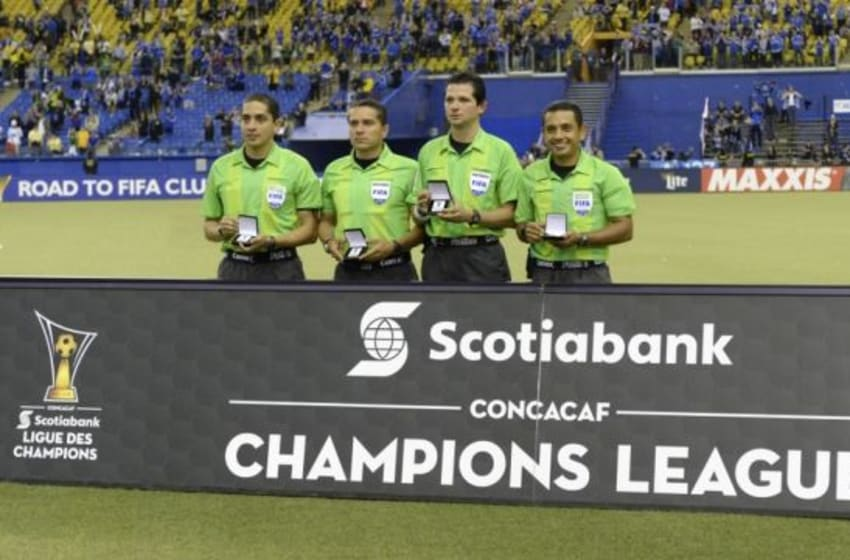 Apr 29, 2015; Montreal, Quebec, Canada; referee Henry Bejarano poses with his crew after the match between Club America and the Montreal Impact in the CONCACAF Champions League final at Olympic Stadium. Mandatory Credit: Eric Bolte-USA TODAY Sports