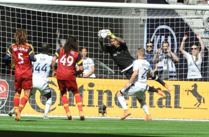 May 30, 2015; Vancouver, British Columbia, CAN; Real Salt Lake goalkeeper Nick Rimando (18) stopos a shot on net by the Vancouver Whitecaps during the second half at BC Place. The Vancouver Whitecaps won 2-1. Mandatory Credit: Anne-Marie Sorvin-USA TODAY Sports