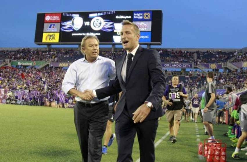 Oct 16, 2015; Orlando, FL, USA; Orlando City SC head coach Adrian Heath and New York City FC head coach Jason Kreis talk before the game at Orlando Citrus Bowl Stadium. Mandatory Credit: Kim Klement-USA TODAY Sports
