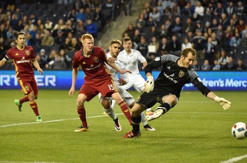 Apr 2, 2016; Kansas City, KS, USA; Real Salt Lake goal keeper Jeff Attinella (23) dives for a ball, that just misses going into the goal against Sporting KC during the second half at Children