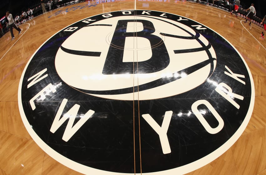 NEW YORK, NY - NOVEMBER 25: The Brooklyn Nets logo adorns center court prior to the game against the Portland Trail Blazers at the Barclays Center on November 25, 2012 in the Brooklyn borough of New York City. NOTE TO USER: User expressly acknowledges and agrees that, by downloading and/or using this photograph, user is consenting to the terms and conditions of the Getty Images License Agreement. (Photo by Bruce Bennett/Getty Images)