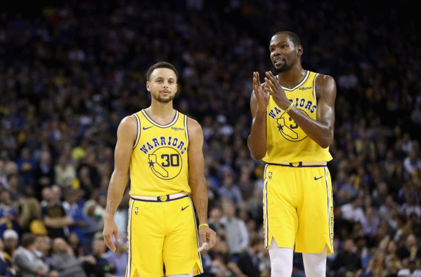 OAKLAND, CA - OCTOBER 24: Stephen Curry #30 of the Golden State Warriors stands on the floor with Kevin Durant #35 during their game against the Washington Wizards at ORACLE Arena on October 24, 2018 in Oakland, California. NOTE TO USER: User expressly acknowledges and agrees that, by downloading and or using this photograph, User is consenting to the terms and conditions of the Getty Images License Agreement. (Photo by Ezra Shaw/Getty Images)