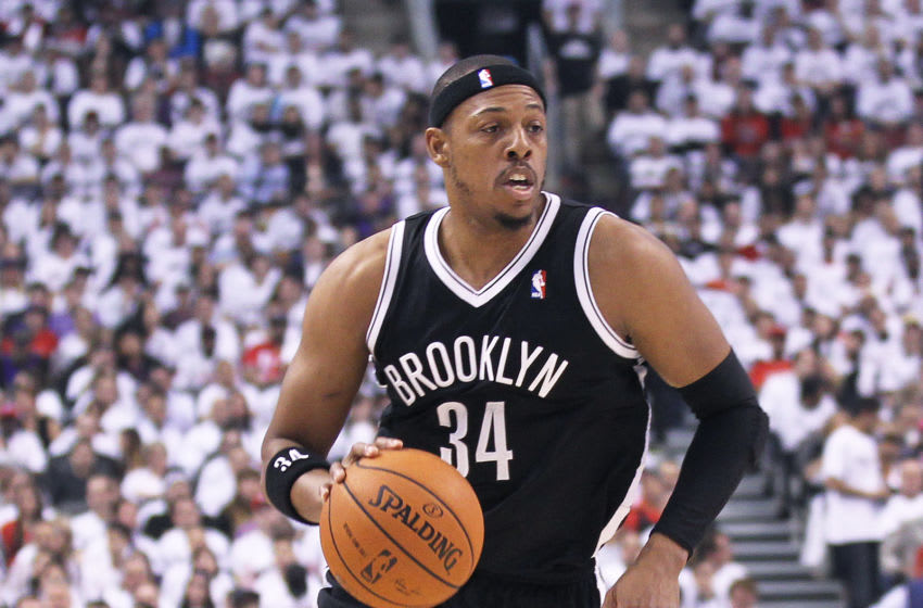 TORONTO, ON - APRIL 22: Paul Pierce #34 of the Brooklyn Nets drives with the ball against the Toronto Raptors in Game Two of the NBA Eastern Conference Play-off at the Air Canada Centre on April 22, 2014 in Toronto, Ontario, Canada. The Raptors defeated the Nets 100-95 to even the series 1-1. NOTE TO USER: user expressly acknowledges and agrees that, by downloading and/or using this Photograph, user is consenting to the terms and conditions of the Getty Images License Agreement. (Photo by Claus Andersen/Getty Images)