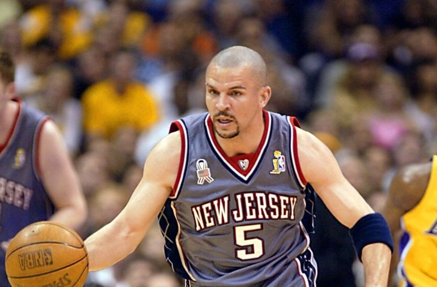 LOS ANGELES, UNITED STATES: Jason Kidd of the New Jersey Nets comes down court against the Los Angeles Lakers during the 1st quarter of game two of the NBA Finals 07 June 2002 at the Staples Center in Los Angeles, CA. The Lakers have a 1-0 lead in the best-of-seven series. AFP PHOTO Jeff HAYNES (Photo credit should read JEFF HAYNES/AFP via Getty Images)