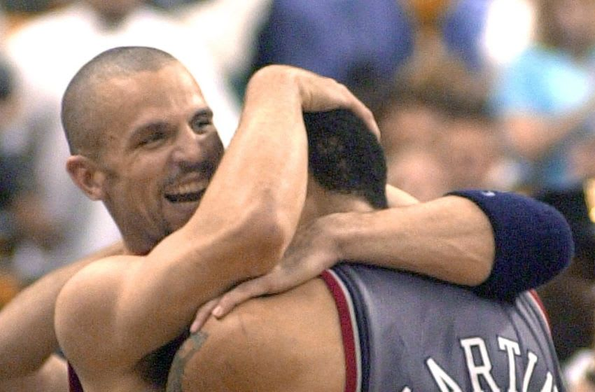 BOSTON, UNITED STATES: Jason Kidd (L) and Jason Kidd of the New Jersey Nets celebrate after beating the Boston Celtics 96-88 in game six to win the Eastern Conference finals 31 May 2002 at the Fleet Center in Boston, Massachusetts. The Nets won the best-of-seven series 4-2. AFP PHOTO/JOHN MOTTERN (Photo credit should read JOHN MOTTERN/AFP via Getty Images)
