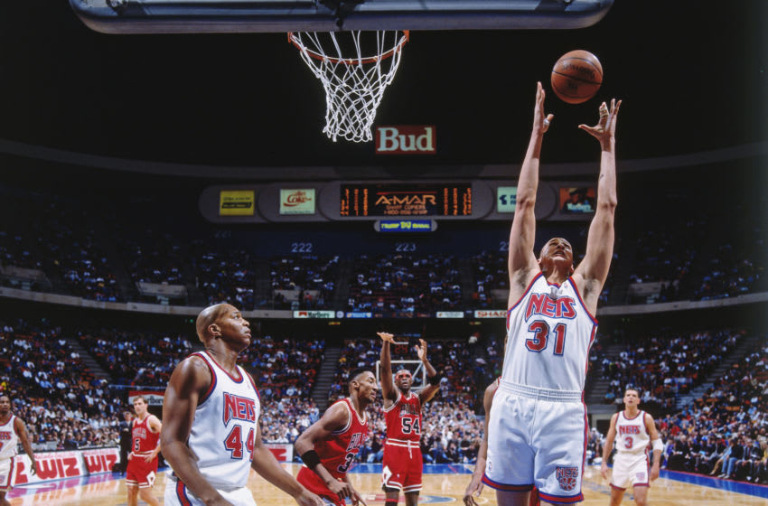 EAST RUTHERFORD, N.J. - 1993: Sam Bowie #31 of the New Jersey Nets rebounds against the Chicago Bulls during a game played circa 1993 at the Brendan Byrne Arena in East Rutherford, New Jersey. NOTE TO USER: User expressly acknowledges and agrees that, by downloading and or using this photograph, User is consenting to the terms and conditions of the Getty Images License Agreement. Mandatory Copyright Notice: Copyright 1993 NBAE (Photo by Nathaniel S. Butler/NBAE via Getty Images)