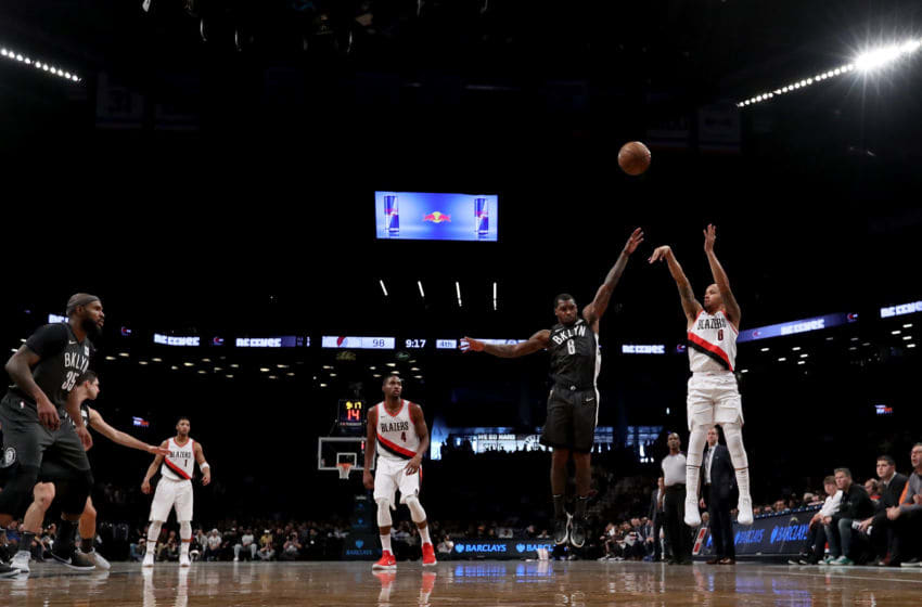 NEW YORK, NY - NOVEMBER 24: Shabazz Napier #6 of the Portland Trail Blazers takes a shot against Spencer Dinwiddie #8 of the Brooklyn Nets in the fourth quarter at Barclays Center on November 24, 2017 in the Brooklyn borough of New York City. NOTE TO USER: User expressly acknowledges and agrees that, by downloading and or using this photograph, User is consenting to the terms and conditions of the Getty Images License Agreement. (Photo by Abbie Parr/Getty Images)