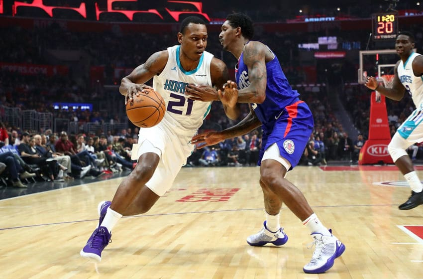 LOS ANGELES, CA - DECEMBER 31: Treveon Graham #21 of the Charlotte Hornets pushes past Lou Williams #23 of the LA Clippers in the first quarter at Staples Center on December 31, 2017 in Los Angeles, California. (Photo by Joe Scarnici/Getty Images)